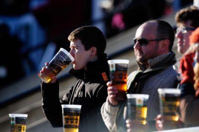 Rugby fans enjoy a beer