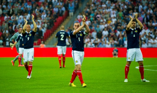 Scotland players applaud the crowd after a 3-2 defeat against England at Wembley