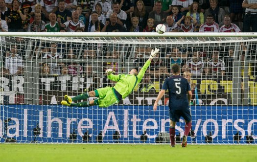 David Marshall at full stretch, as Muller opens the scoring